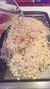 coconut oil poured onto granola